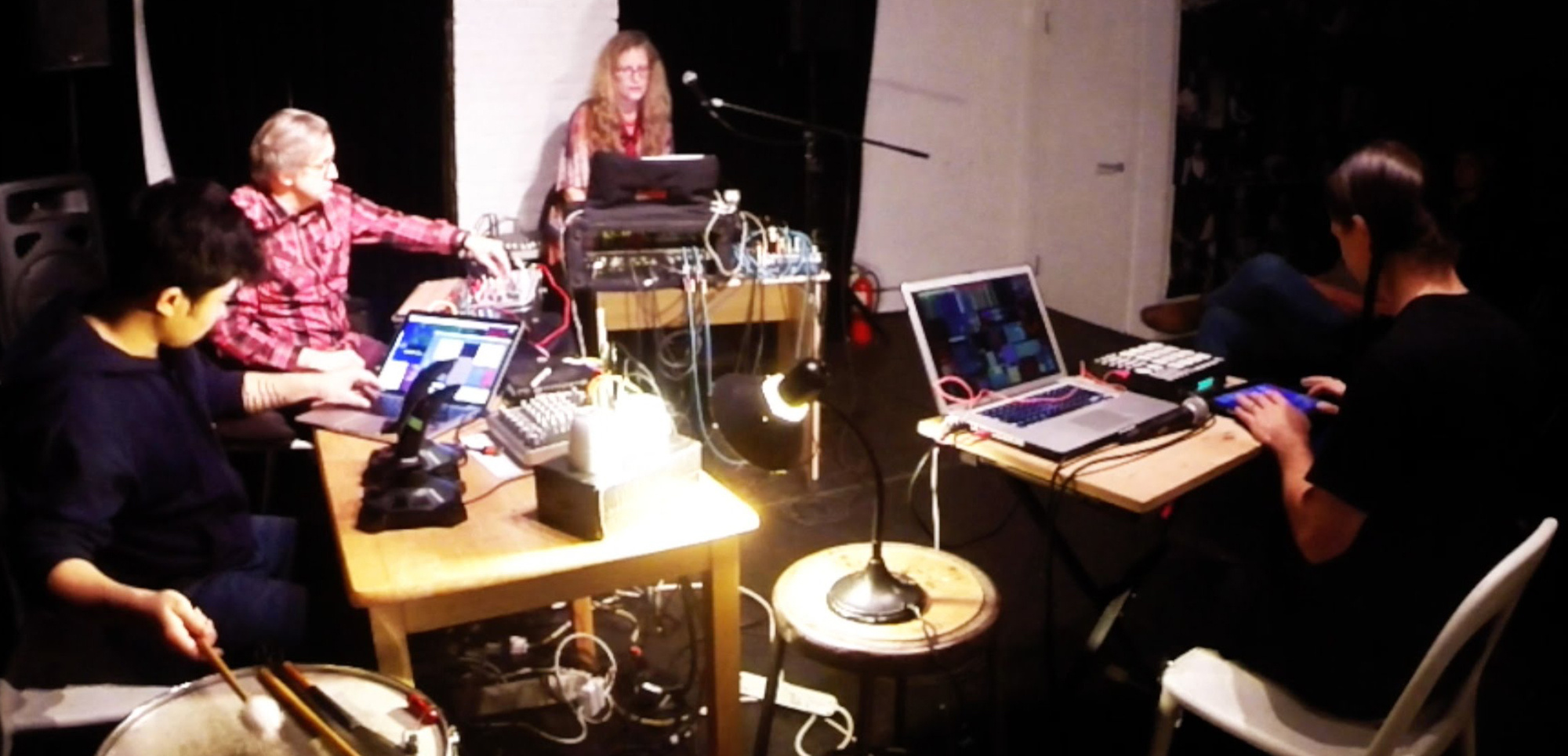 A performance during Chuck Bettis's residency at The Stone in December 2015 featuring (from left to right): Levy Lorenzo (electronics, percussion, and tea pot); Hans Tammen (Buchla, etc.); Dafna Naphtali (electronics and voice); and Chuck Bettis (electronics).