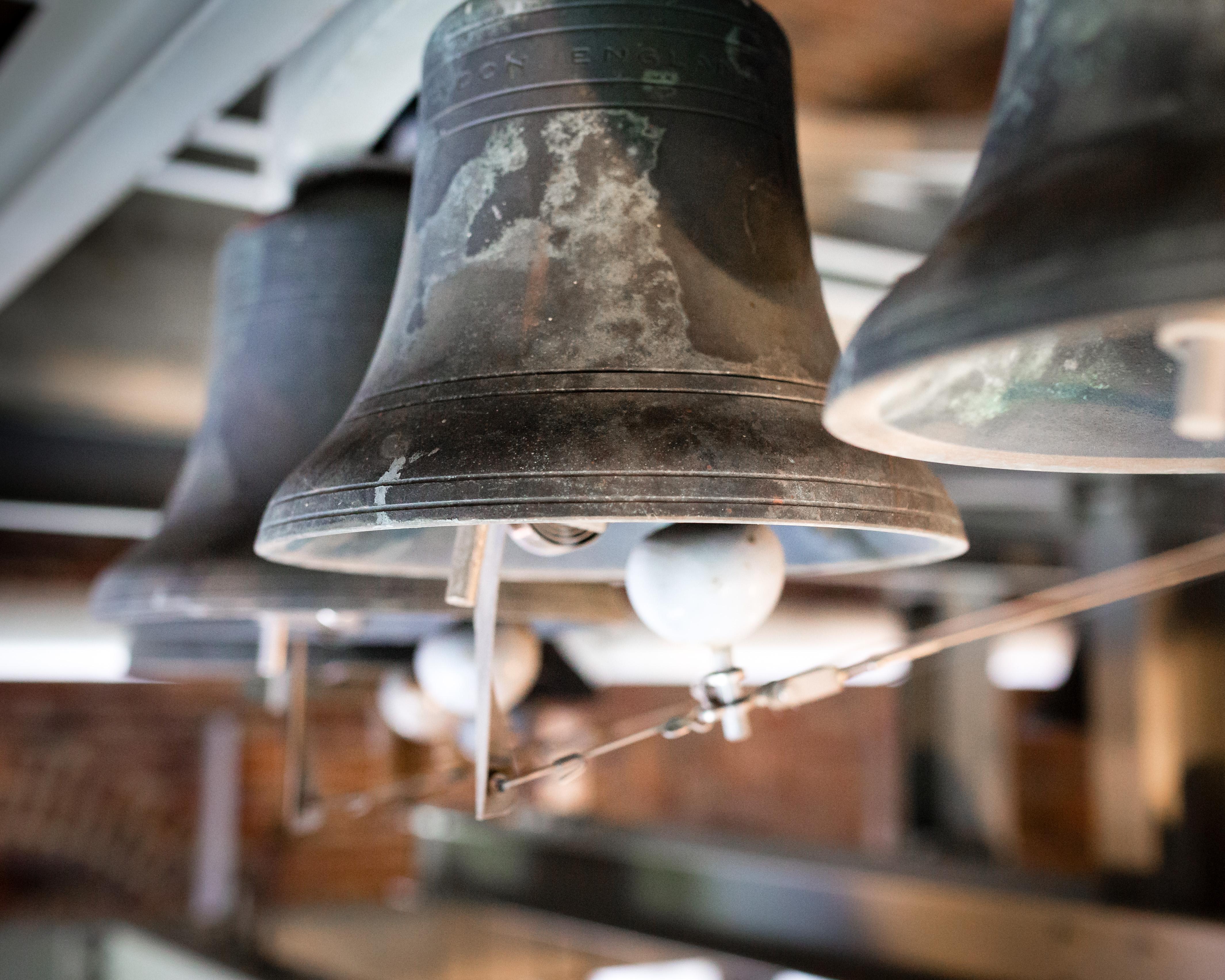 A close up of three carillon bells
