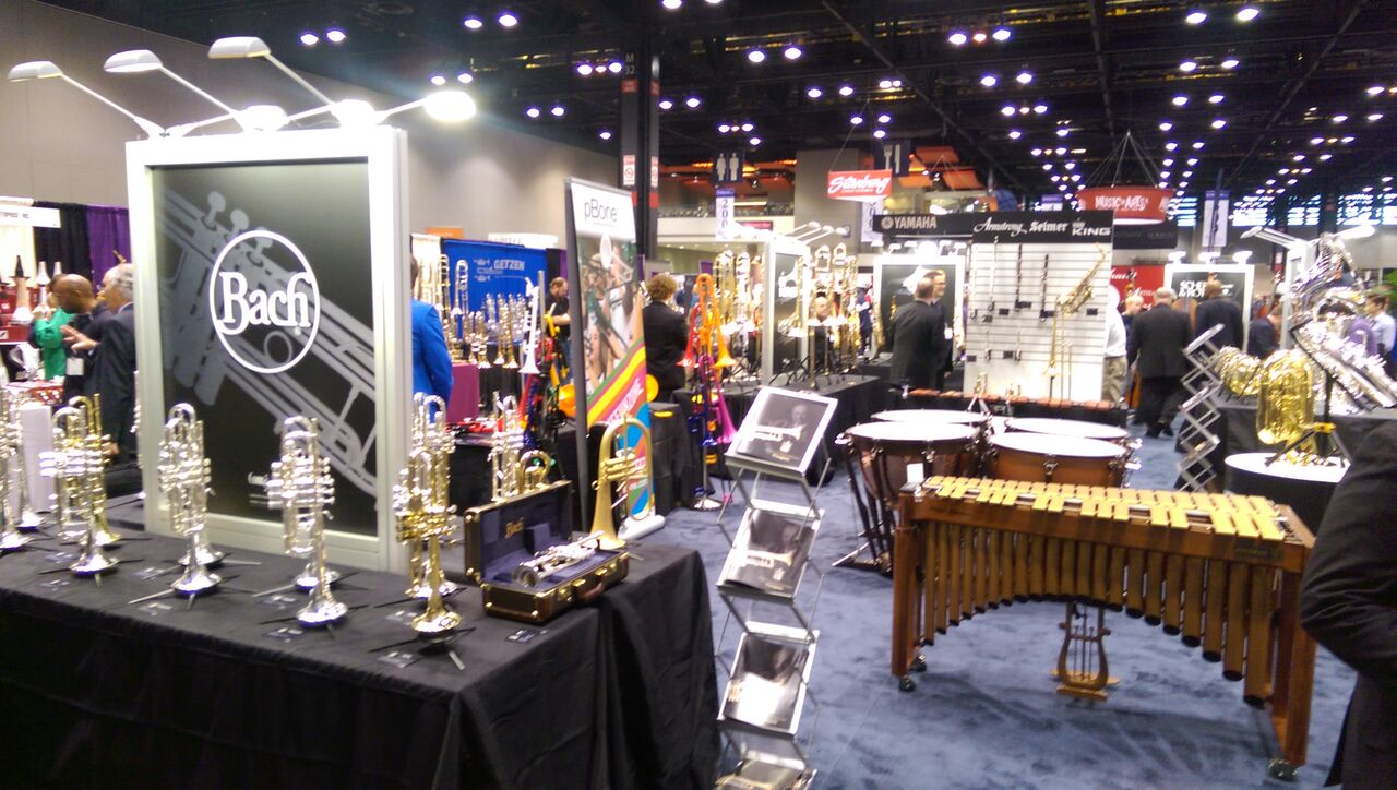 Trumpets and metallophones on display from musical instrument vendor booths at the 2015 Midwest Clinic.