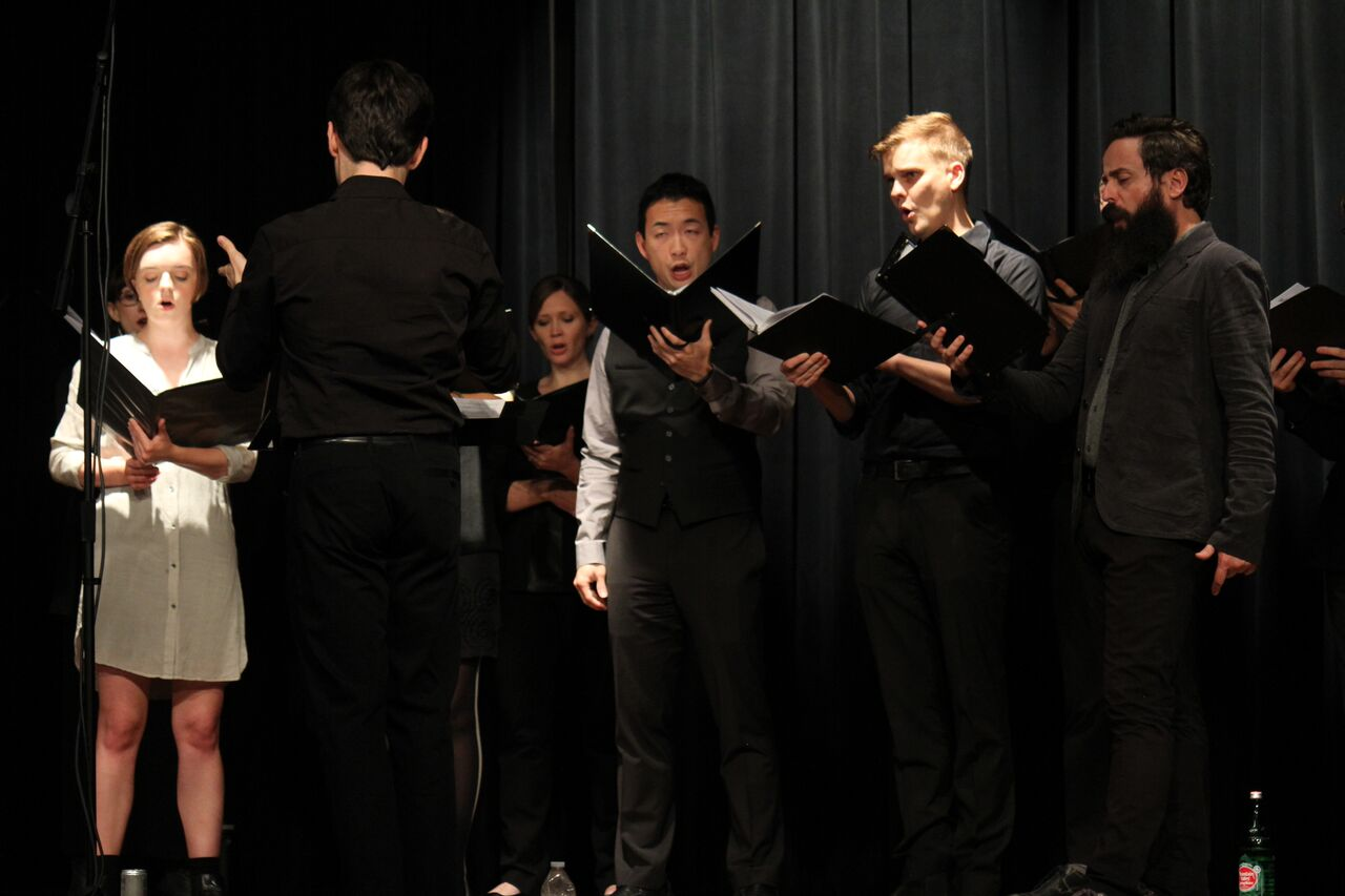 C3LA performing Maskil of David (a group of choristers singing from scores in binders and a conductor)