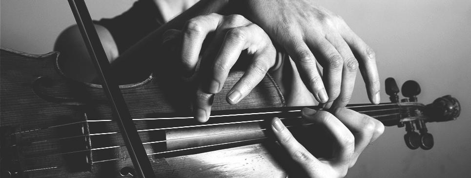 "Josh Modney and Kate Soper's hands on the neck of a violin ""hands"" banner image (photo credit: Alexander Perrelli & Emma Van Deun)"