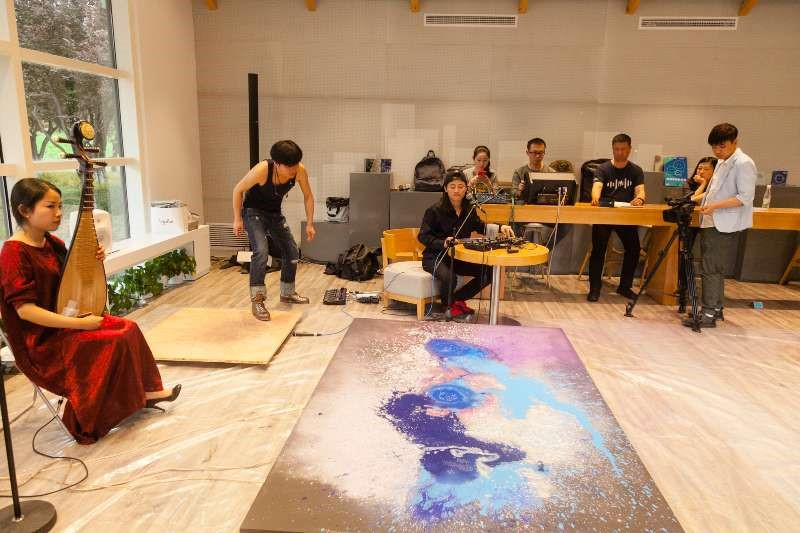 A performance involving pipa, a dancer, a painting, and electronics.