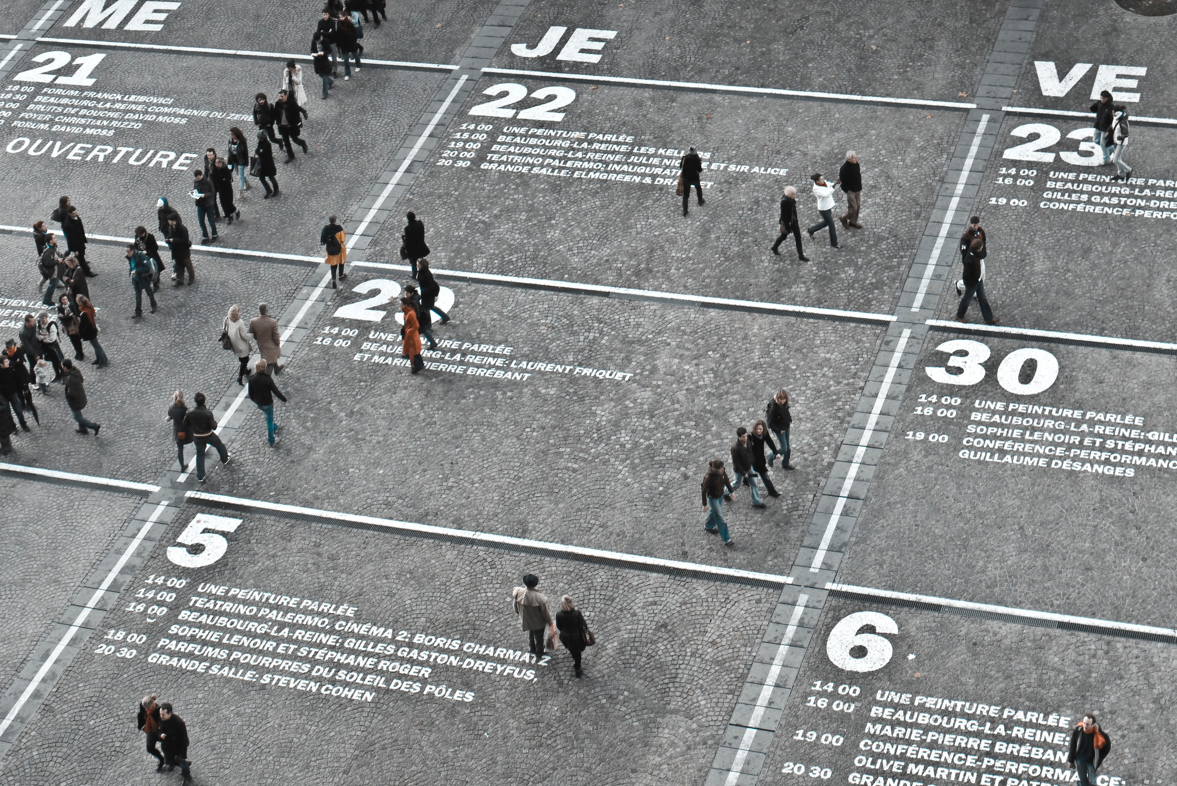 A street at the Centre Pompidou in Paris on which I calendar grid has been painted showing people walking through various days