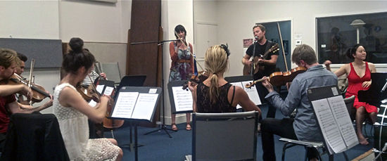 Zach Rogue and Minna Choi, far right, rehearsing with members of the Magik*Magik Orchestra.