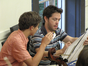 Shepherd working with young composer Paul Novak at an RPYO rehearsal.