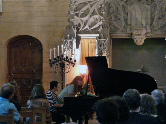 Sarah Cahill (standing) and Regina Schaffer performing a work by Terry Riley in the Chimes Chapel