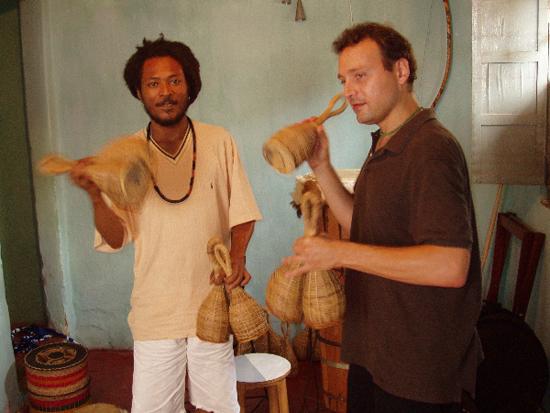 Bermel playing caxixi in Brazil