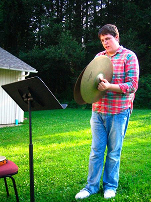 Nathan von Trotha practicing the cymbals outside at BUTI