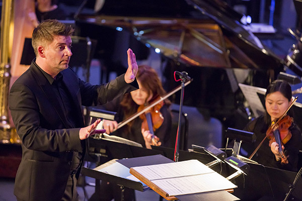 Matthias Pintscher conducting members of the New York Philharmonic in Contact!  At the Biennial:  Beyond Recall at Museum of Moder Art, 5/29/14. Photo by Chris Lee