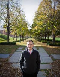 R. Andrew Lee walking among trees