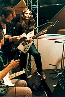 Laurie Spiegel playing an electric guitar