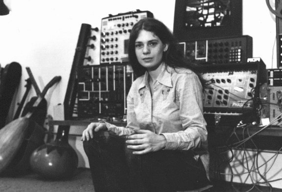 Spiegel sitting in front of synthesizers and a tamboura