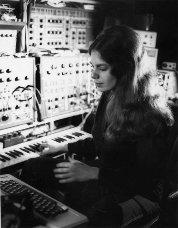 Laurie Spiegel with various patchcord analog synthesizers and a keyboard console