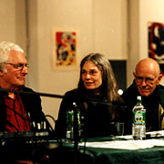Robert Moog, Laurie Spiegel, and Max Matthews seated together at a table.