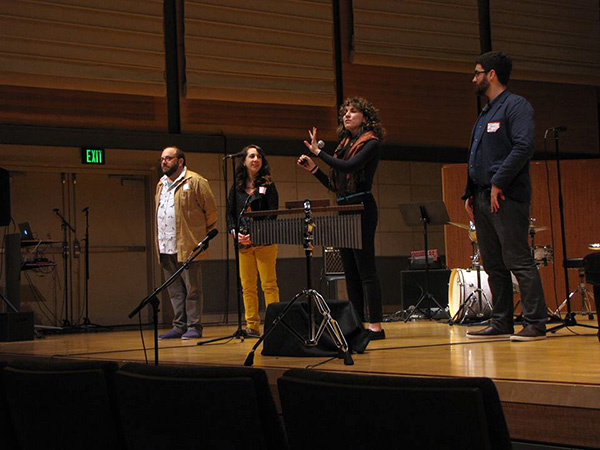 Gathering organizers Daniel Felsenfeld, Mary Kouyoumdjian, Lainie Fefferman, and Matt Marks on stage.