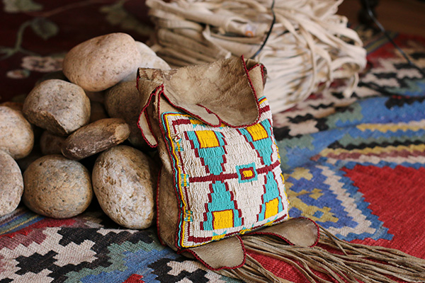 A group of rocks and a pouch on top of a native American rug