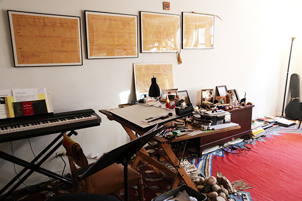 Kitzke score pages in frames on a wall, an electric keyboard, and various native American trinkets.