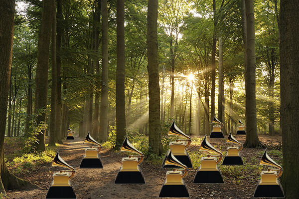 A photoshopped image of a bunch of Grammy awards in the middle of a forest