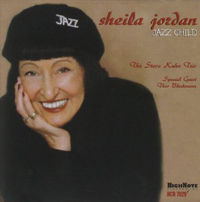 Cover of CD Jazz Child which features a picture of Sheila Jordan wearing a cap that says jazz, smiling, and with her right hand on her right cheek.