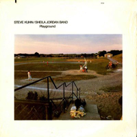 Cover of Playground LP featuring a photo of a park below a staircase with someone sitting on the steps; in the park is a baseball diamond on which a group of people are in the middle of a game.