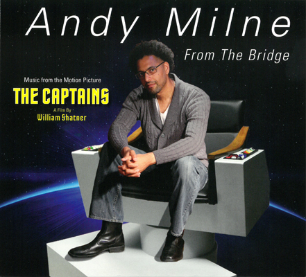 Cover of Andy Milne's CD From The Bridge featuring a photo of Milne sitting on the captain's chair of the Enterprise from Star Trek.