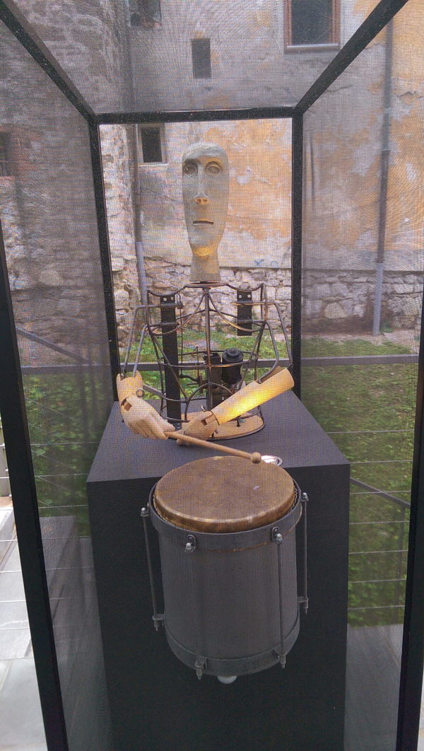 A sculpture of a man playing a tenor drum that actually moves.