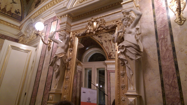One of the doorways of the extremely ornate Orfejev Salon whose side beams are two larger than lifesize sculptures of women.