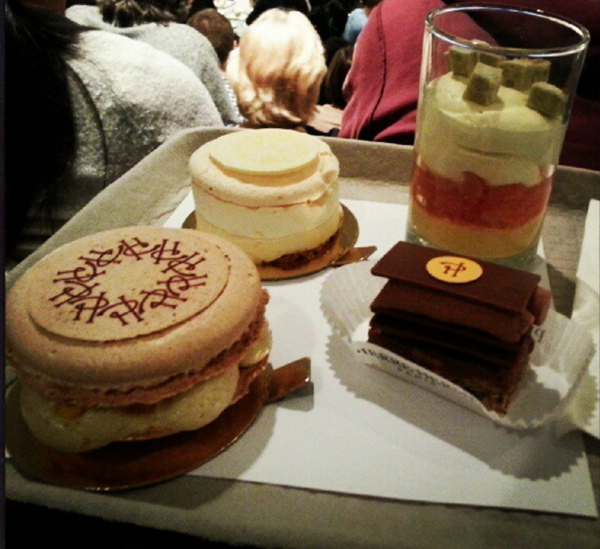 An assortment of desserts on a tray.