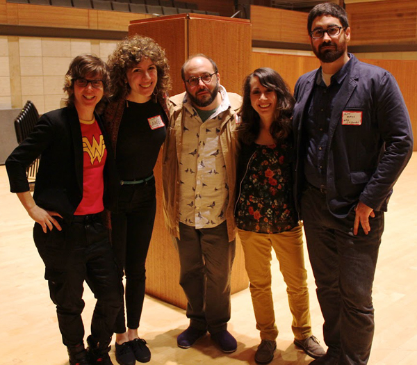 Claire Chase, Lainie Fefferman, Daniel Felsenfeld, Mary Kouyoumdjian, and Matt Marks standing together in an empty room.