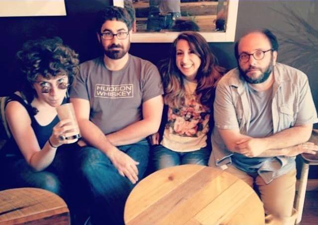 Lainie Fefferman, Matt Marks, Mary Kouyoumdjian, and Daniel Felsenfeld sitting together at a round table.