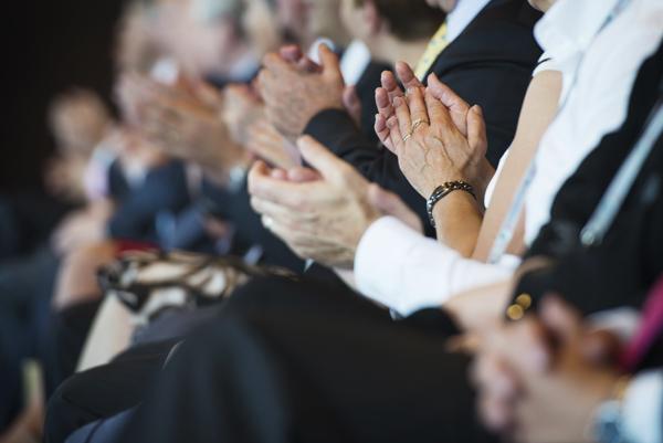 Hands of people applauding