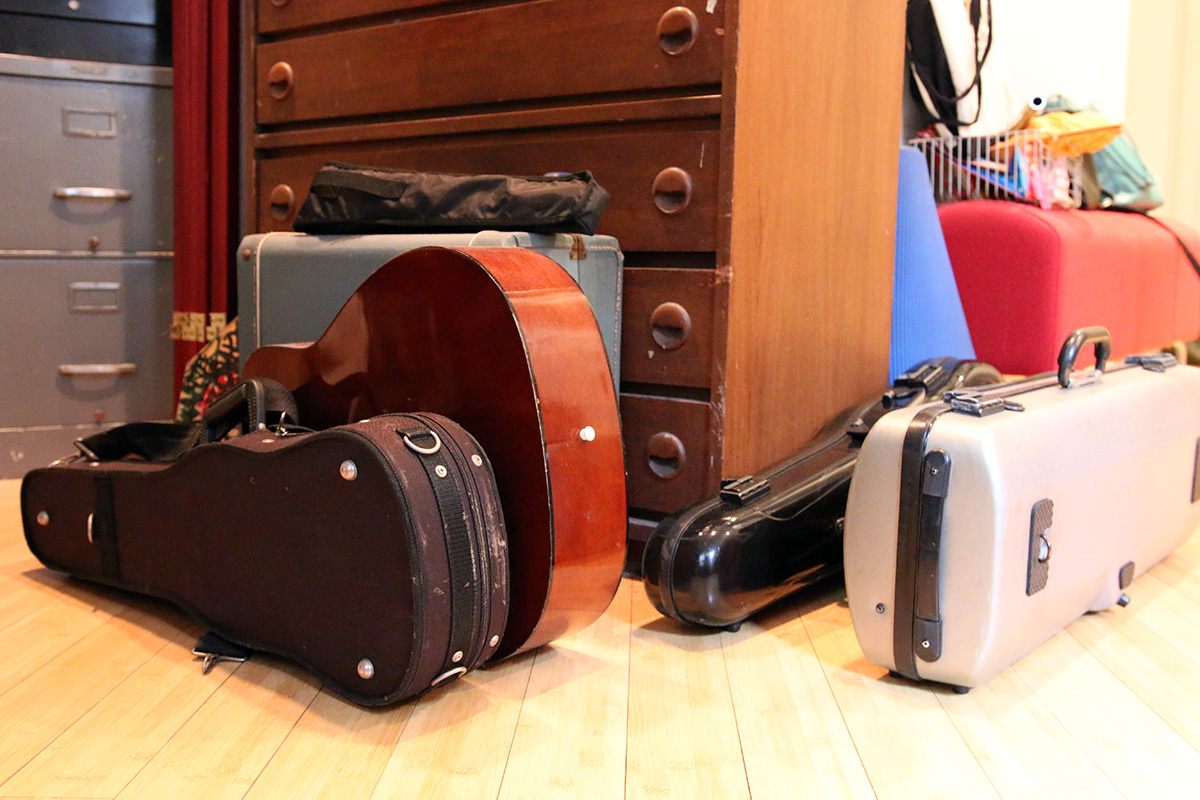 A bunch of instrument cases on the floor.