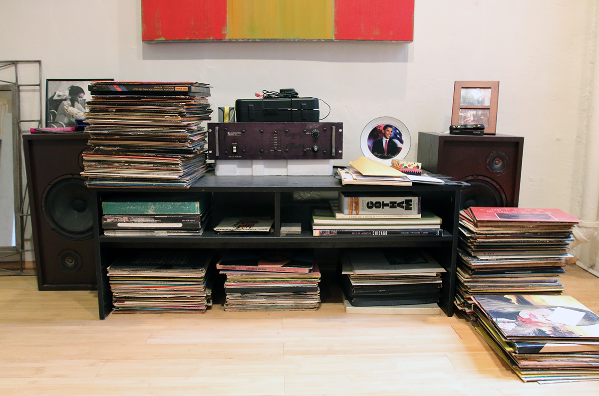 Piles of LPs on the floor.