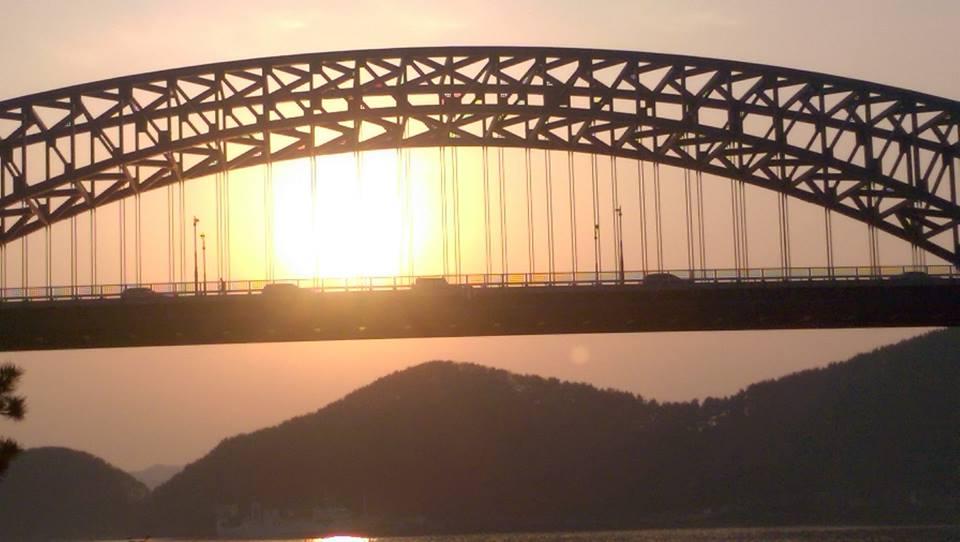 The sun rising behind a bridge in Tongyeong.