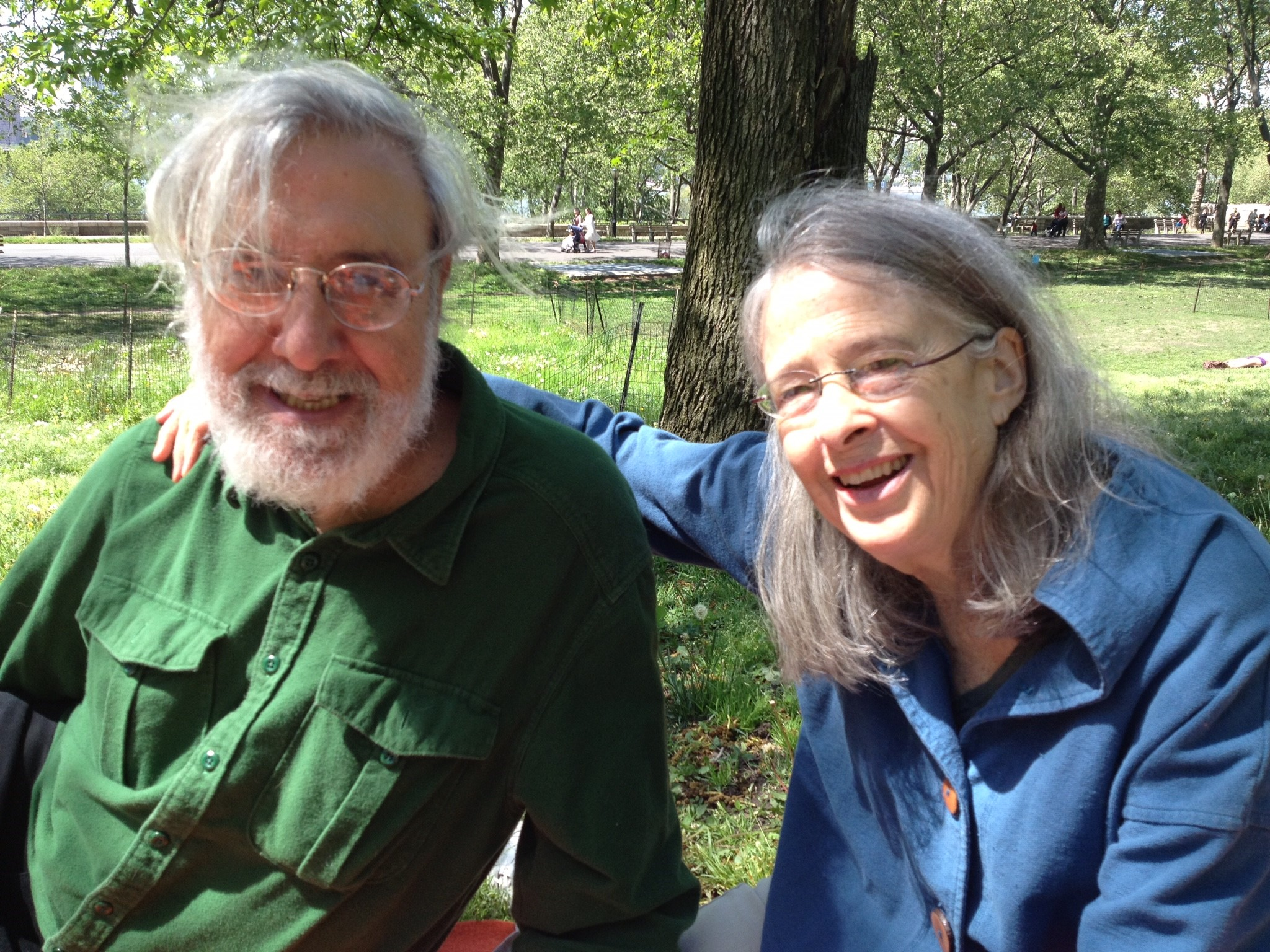 Joel Gressel and Eleanor Cory on a bench in a park.