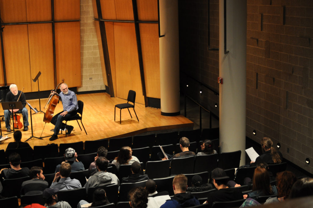 Cellist and Playground Ensemble member Richard vonFoerster gives feedback to the composer.