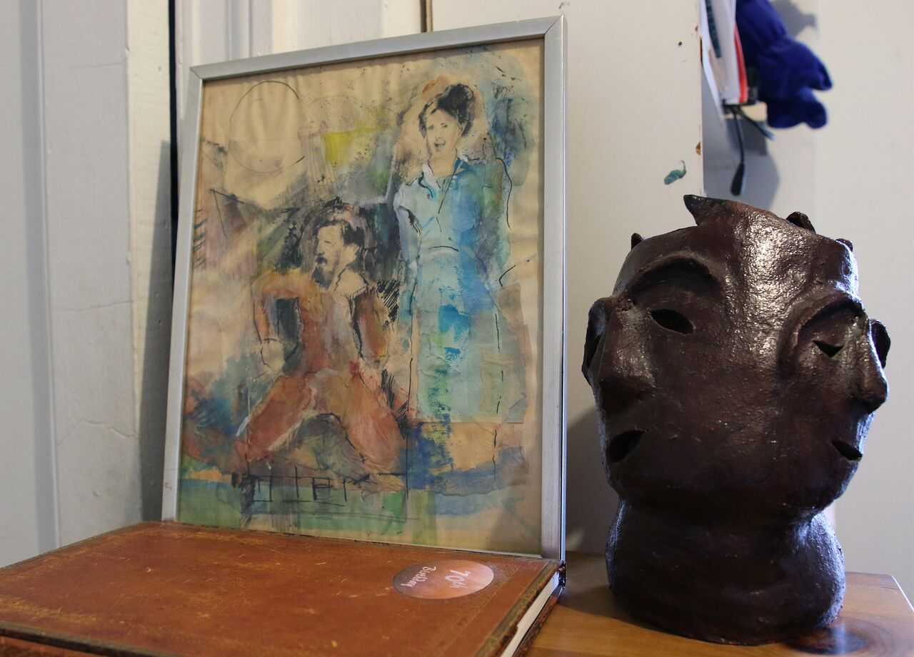 A portrait of Joel Gressel and Eleanor Cory sits next a sculpture in Cory's composition studio.