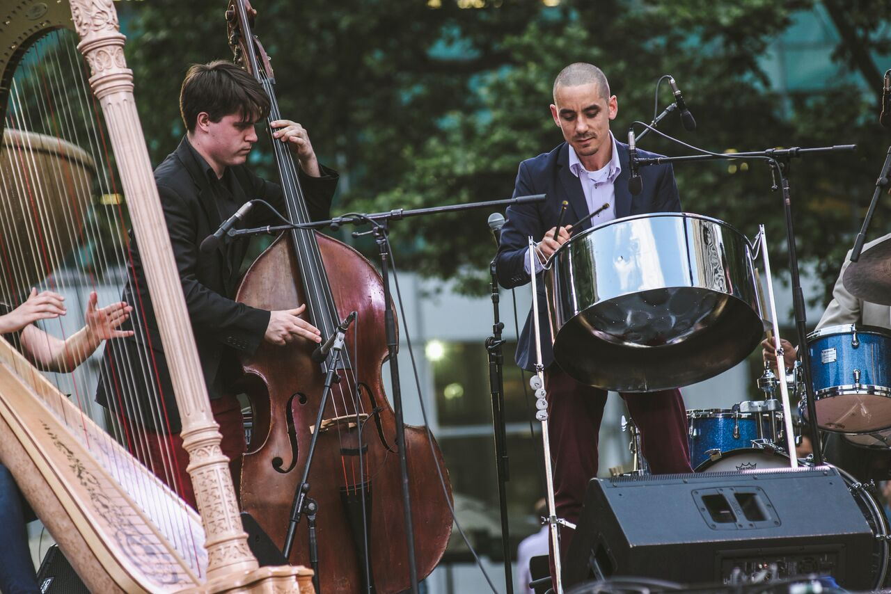 Andy Akiho performing on steel pans along with harp and double bass during the June 10, 2016 IN/TERSECT concert in Bryant Park