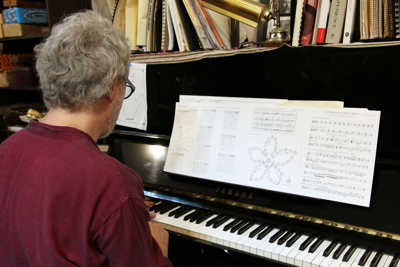 Adam Rudolph at the piano demonstrating his