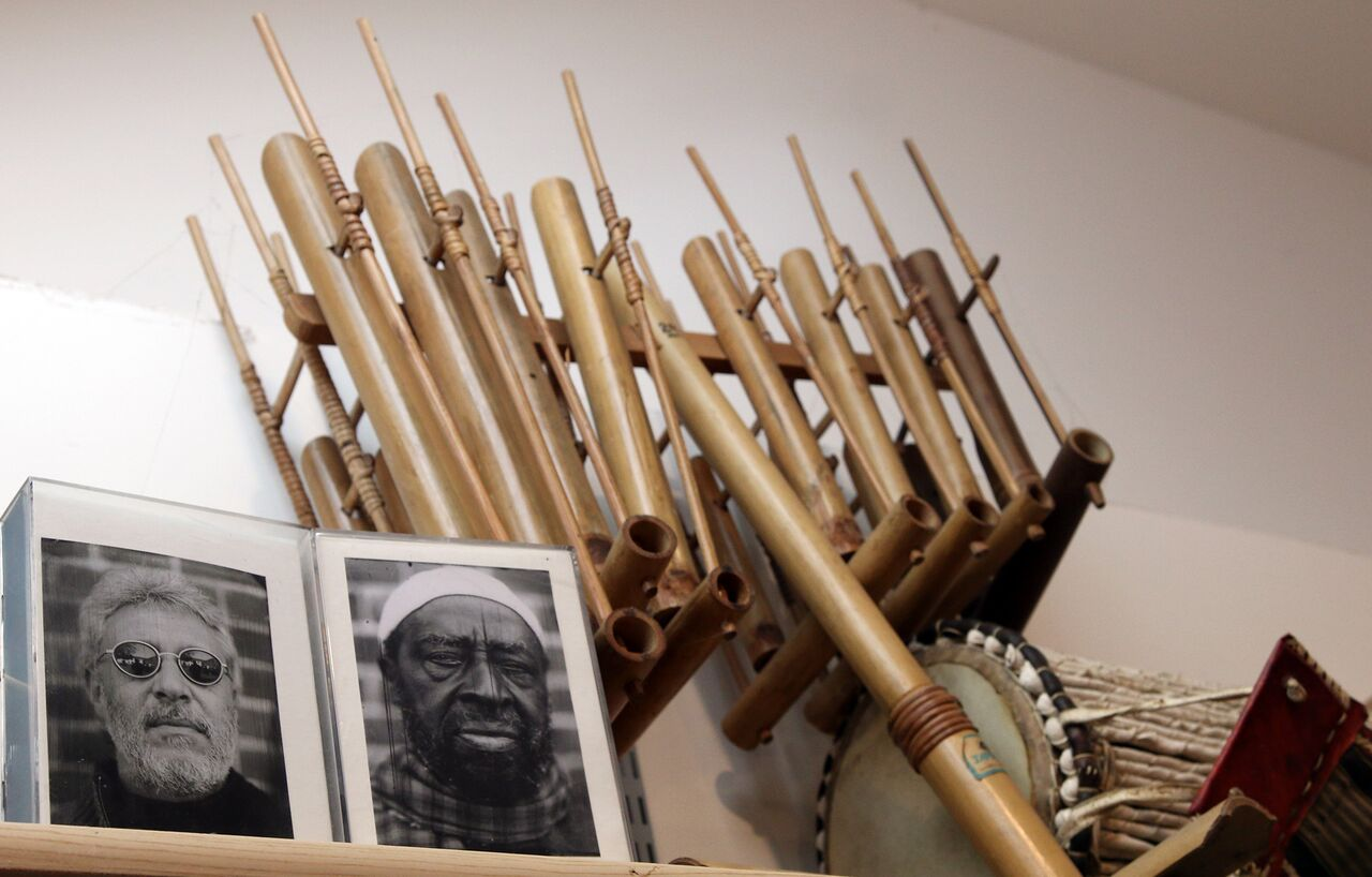Photos of Adam Rudolph and Yusef Lateef in front of various ethnic percussion instruments.