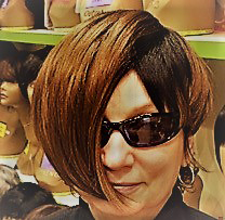 The author posing with wig and sunglasses for her alias Madison Goodwin