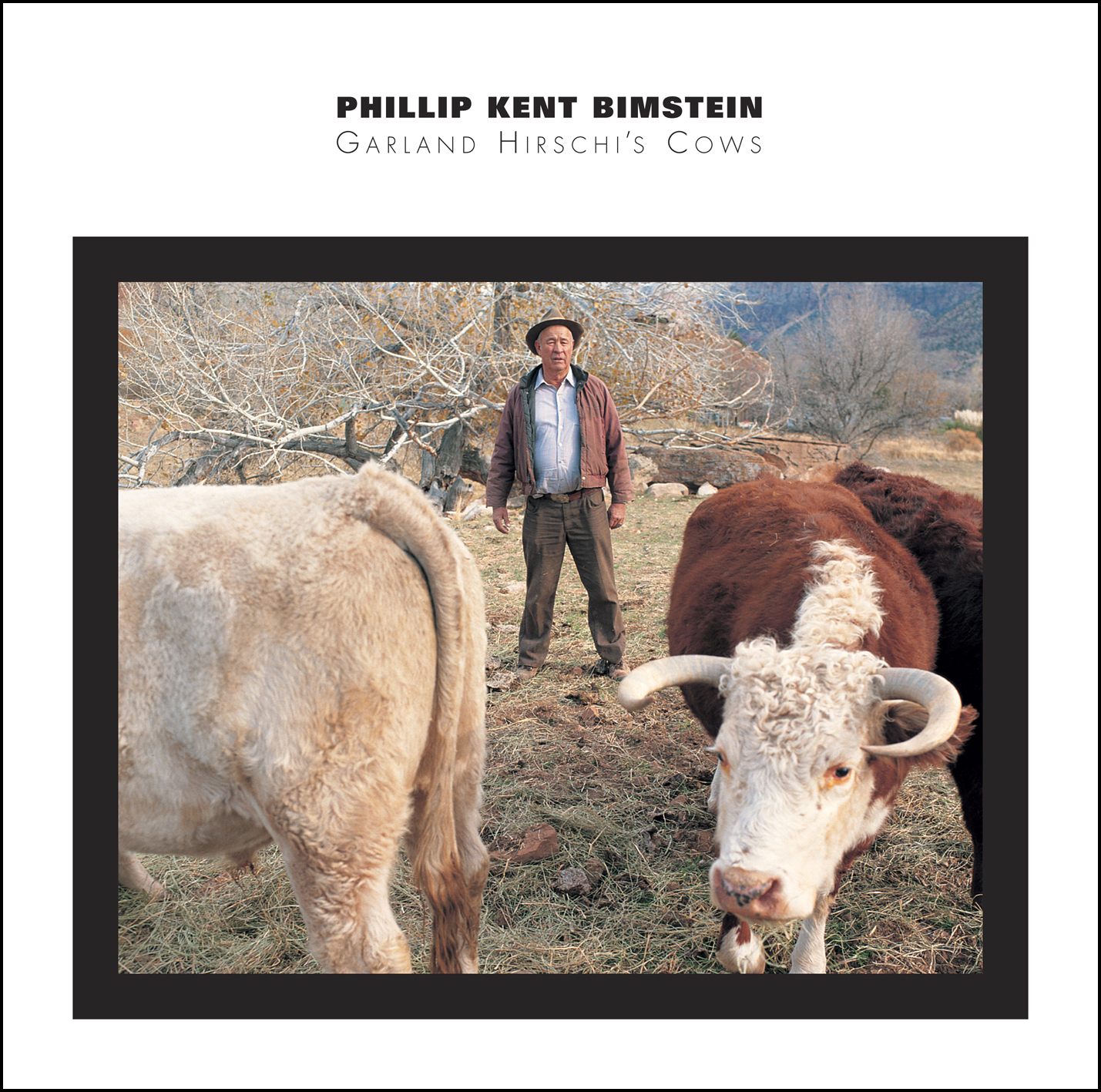 The cover for Philip Bimstein's Starkland CD Garland Hirschi's Cows which is a photo of a farmer with a pair of cows.