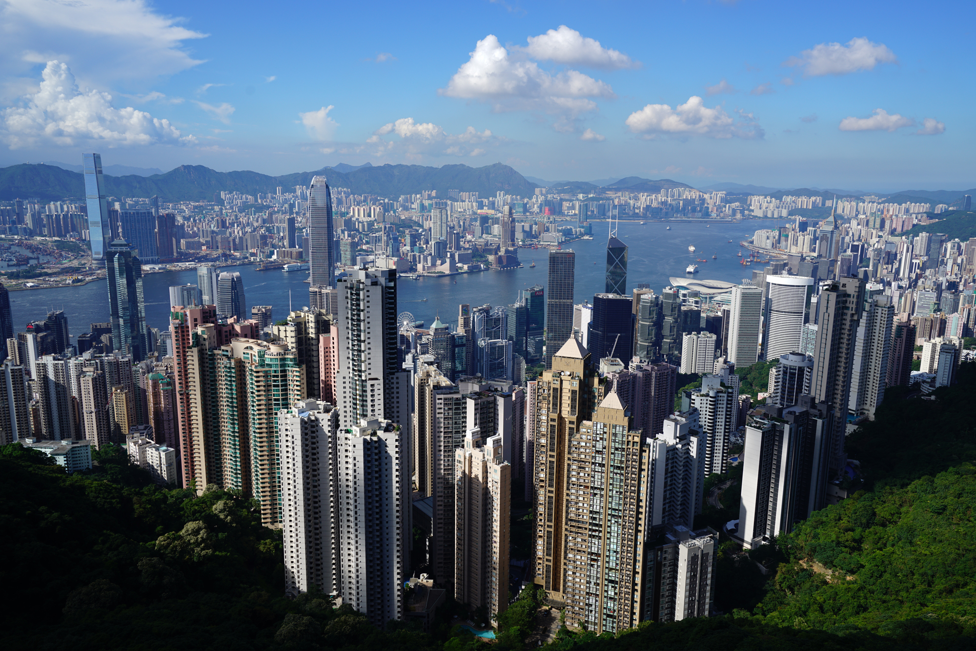 An aerial view of Hong Kong at mid-day from Victoria Peak showing a group extremely tall skyscrapers, Photo courtesy of the Information Services Department of HKSARG