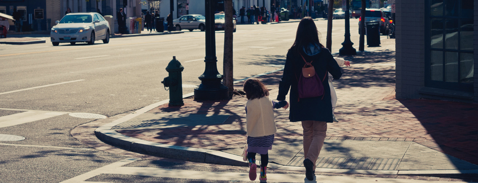 """""""Hard-working Mother"""" (mother holding the hand of a child, walking down a city street) Image © Allen Ran Photography via Flickr Creative Commons"""