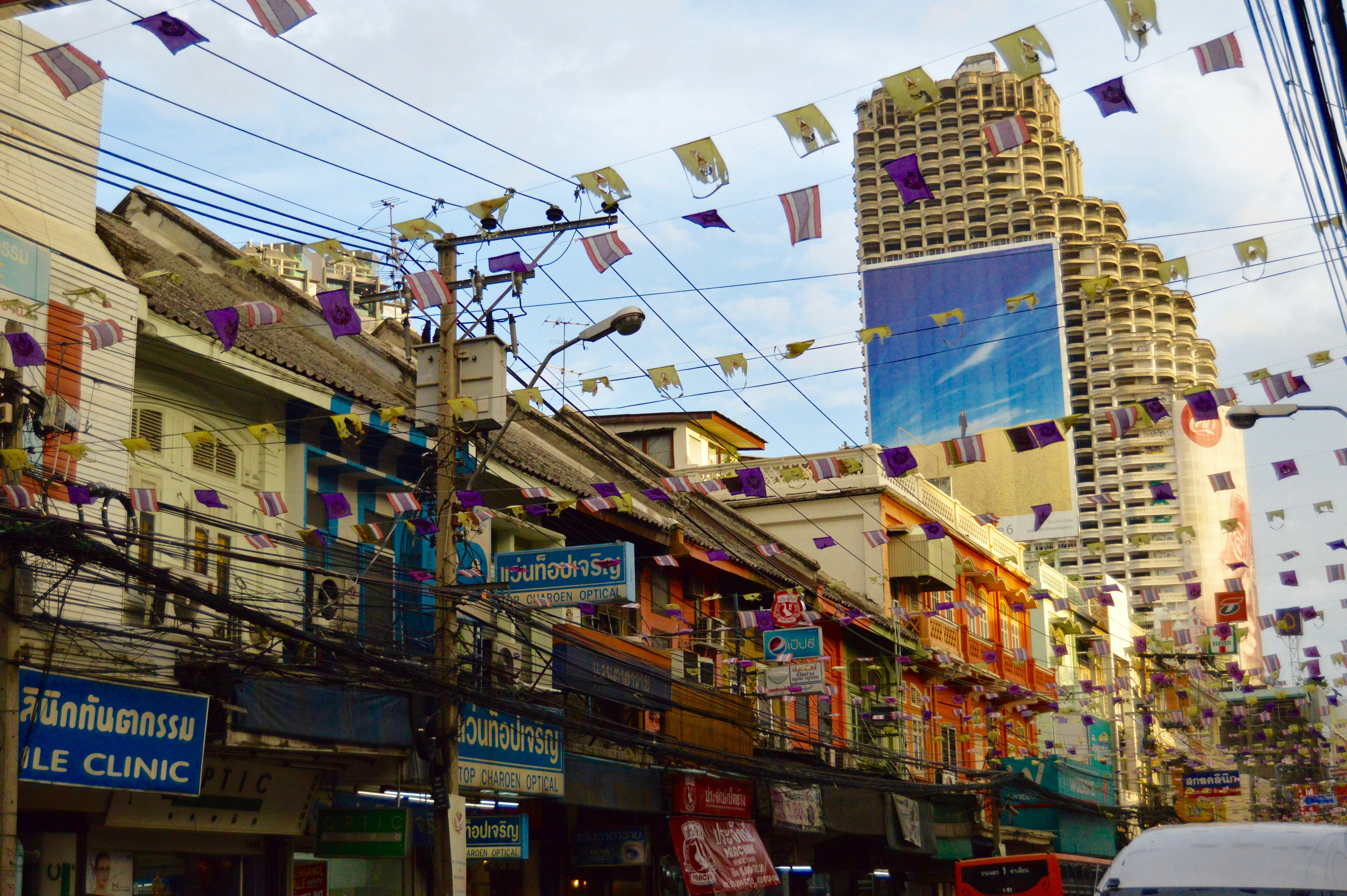 Shops and skyscrapers on a street in Bangkok.