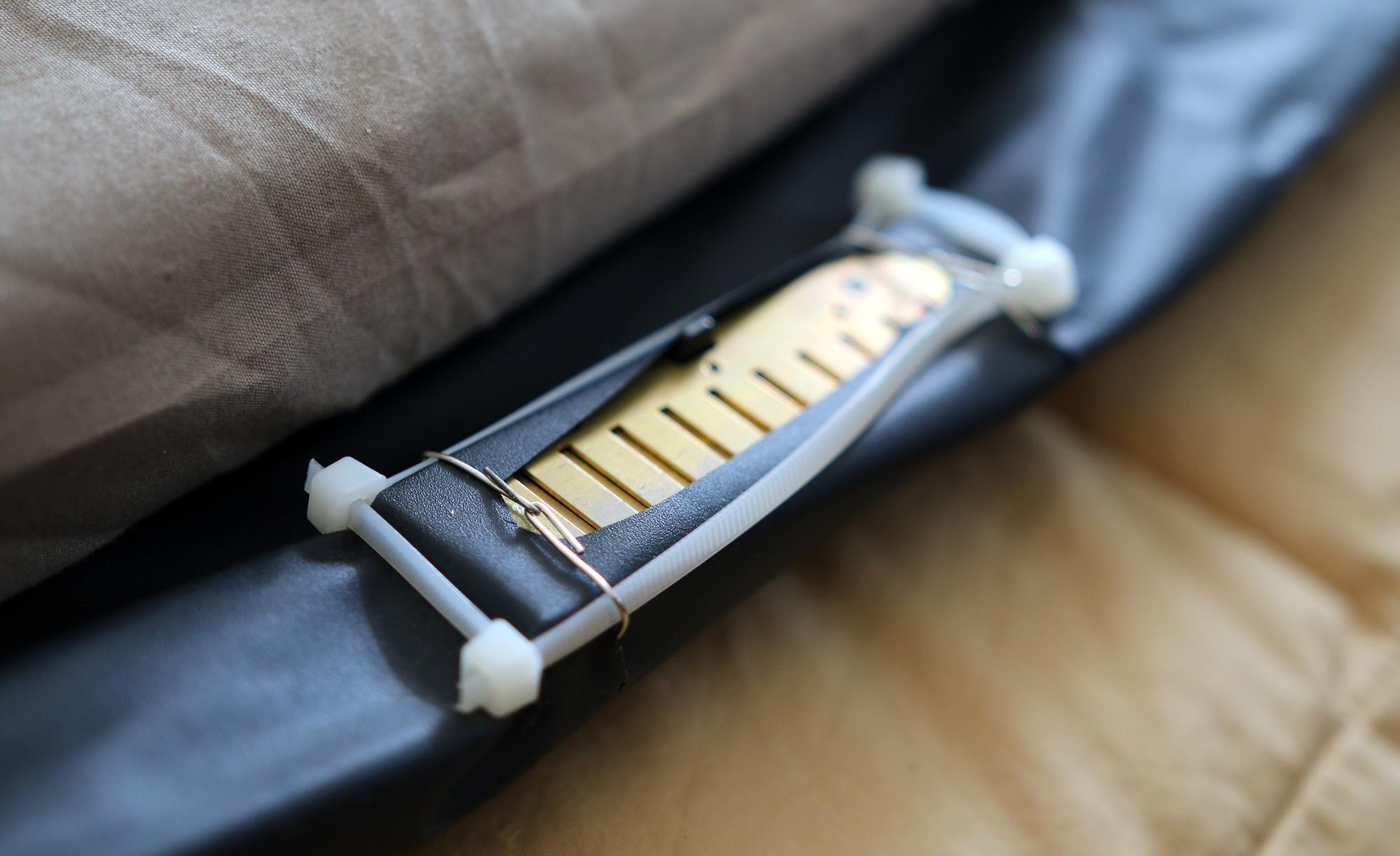 A deconstructed harmonica affixed to an air mattress.