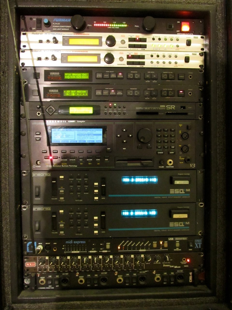 A rack of 1980s hardware synths