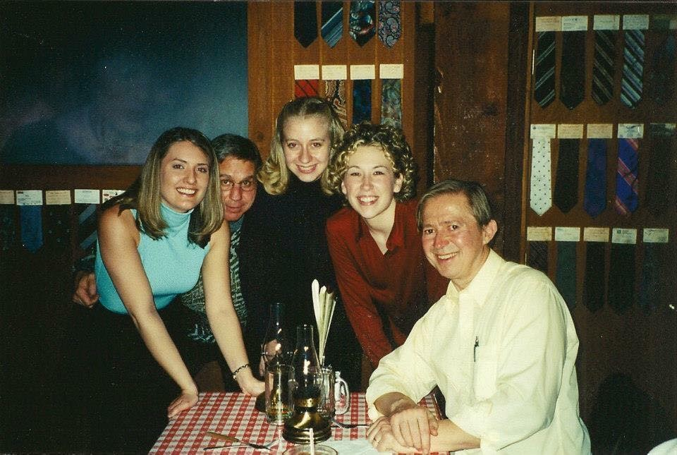 David Maslanka (far right) and Stephen K. Steele (center) with students: taken at a steak house during the Symphony No. 5 tour and CBDNA performance in Denton, TX, February 2001