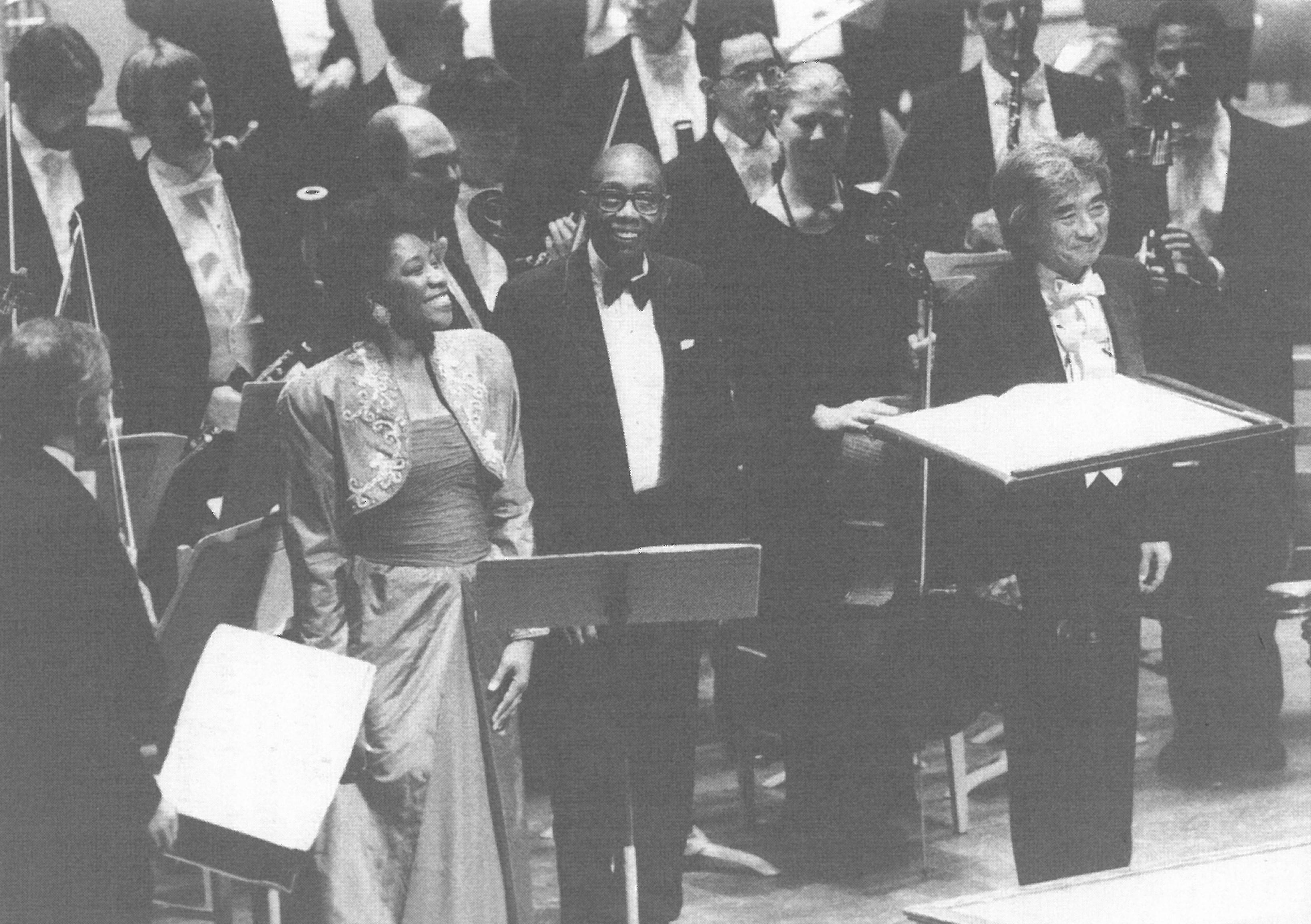 Historic photo of soprano Faye Robinson, George Walker, and conductor Seiji Ozawa with the Boston Symphony Orchestra on the stage of Orchestra Hall in Boston in 1996.