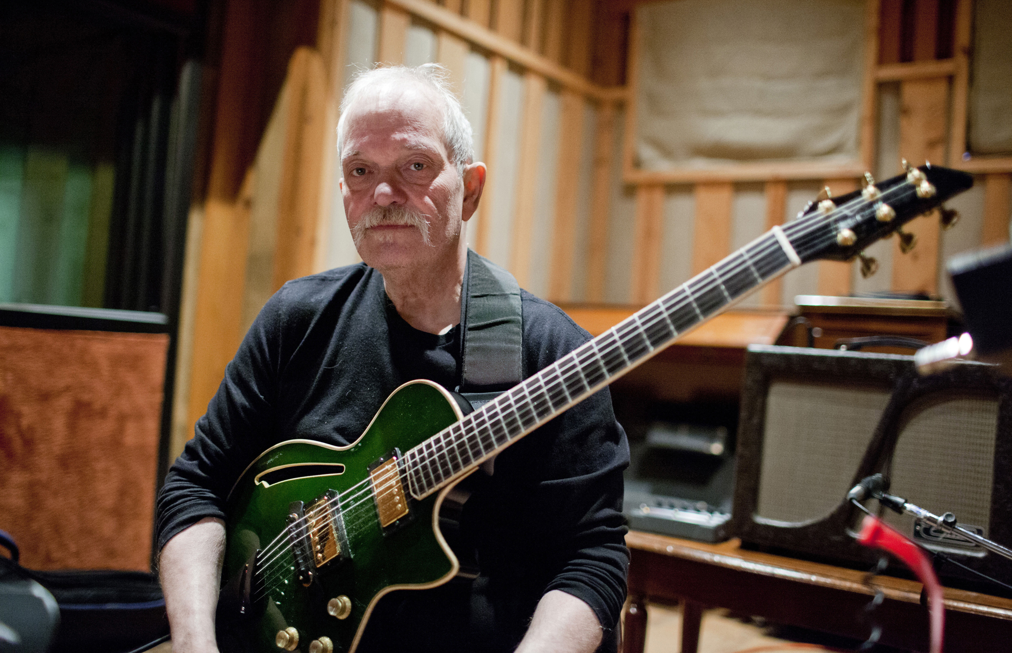 John Abercrombie and his guitar (Photo by John Rogers, courtesy ECM)